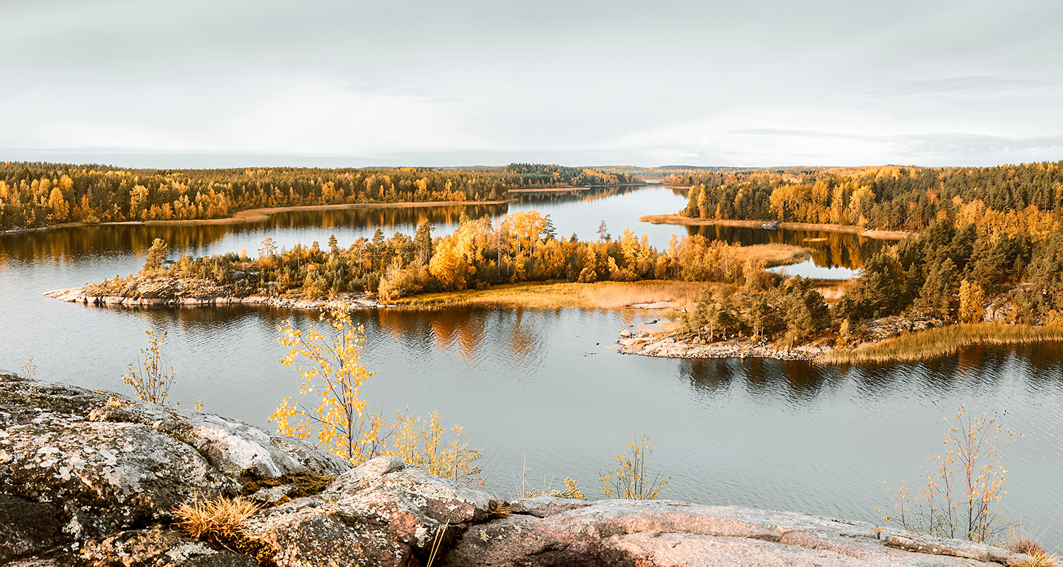 Beautiful view of islands with autumn forest. Fall foliage. Horizontal layout  for travel materials